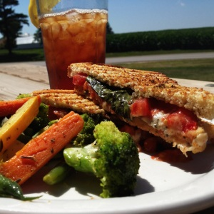 The basil in this pesto panini was harvested from Liz's own garden, while the tomatoes were from Pheasant Run Farms. The roasted vegetables were part of the CSA share from Grinnell Heritage Farms.