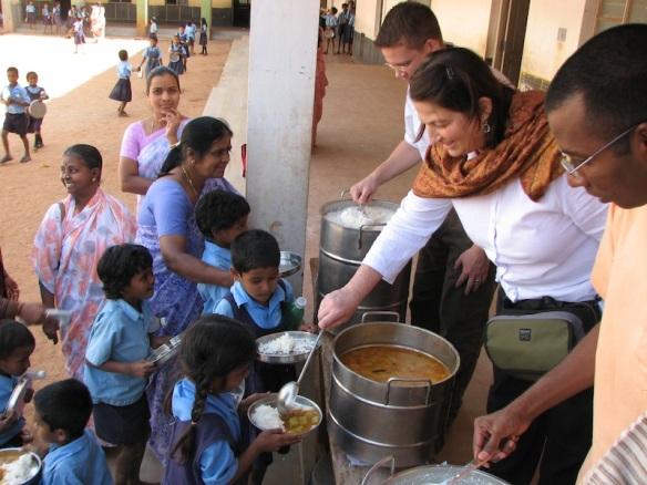 Kathy and Kai feed Indian kids