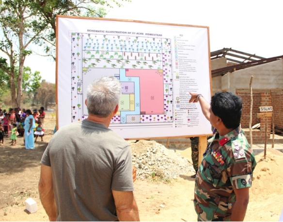 Frontier Co-op CEO Tony Bedard (left) reviews the layout of homesteads provided by Sri Lankan government.
