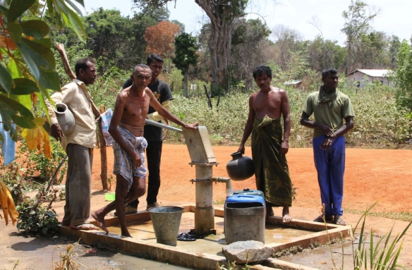 villagers using wells