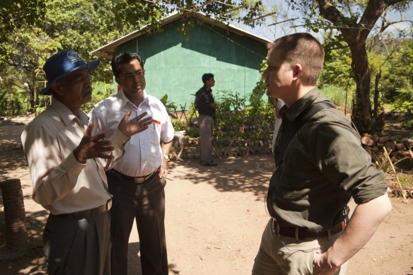 Frontier Co-op Purchasing Manager Kai Stark talks with farmers in Sri Lanka.